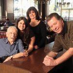 family posing in the diner
