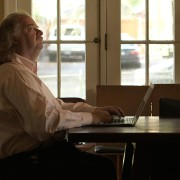 Jonathan Gold writing in a breakfast nook