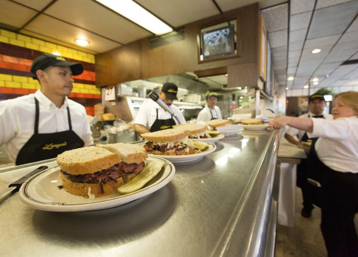 freshly made sandwiches line the server's counter