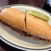 beef brisket dip sandwich with a pickle at Langer's Deli