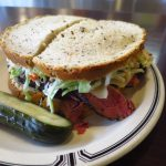 delicious pastrami sandwich on rye bread with cole slaw